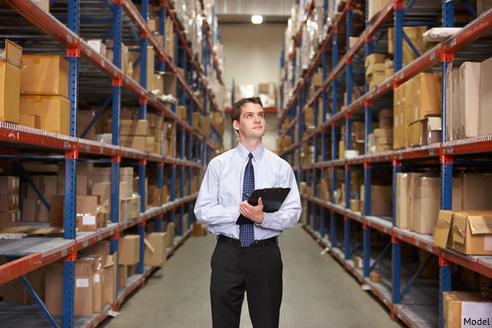 Manager looking at disposable inventory considering what to do with it